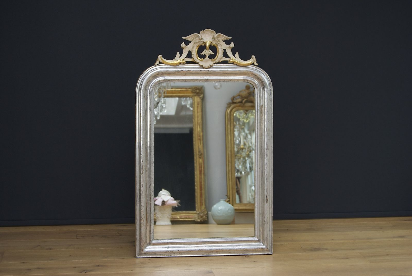 French mirror with a pretty crest