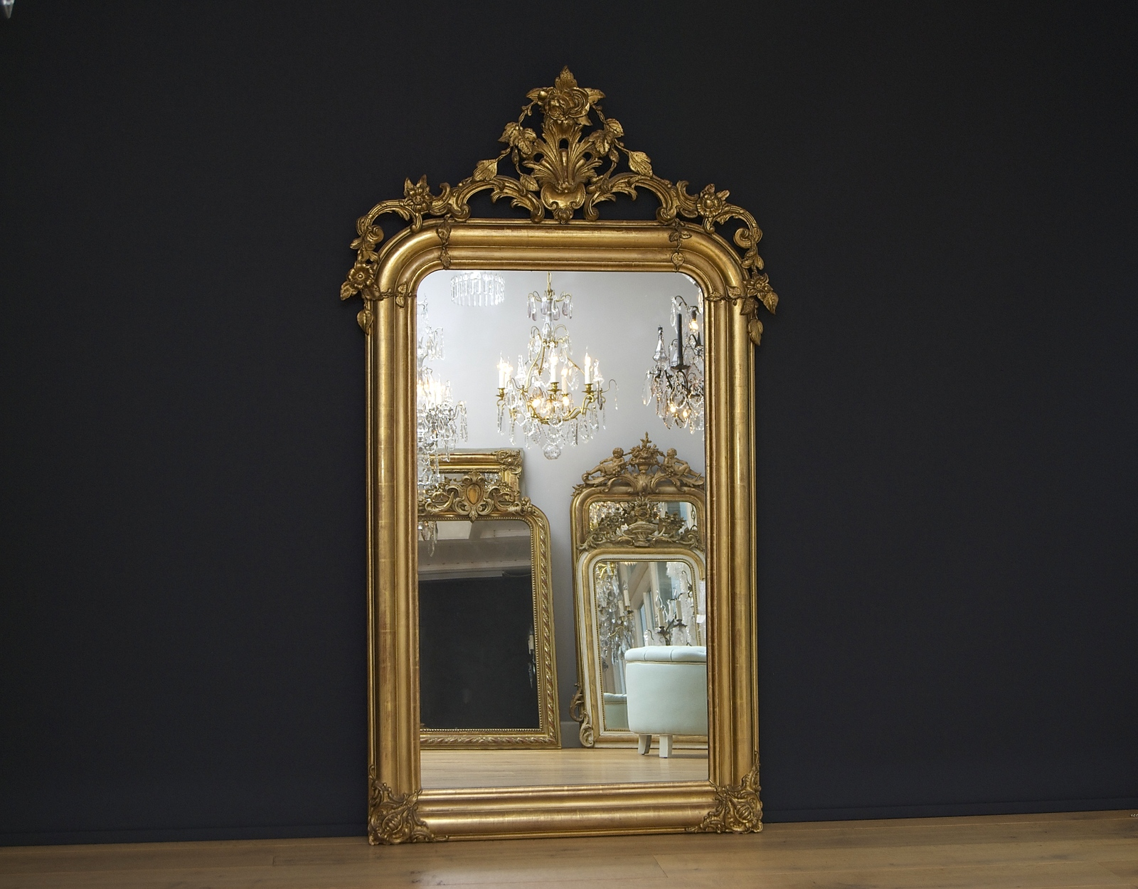 19th century French gilded mirror with a magnificent crown