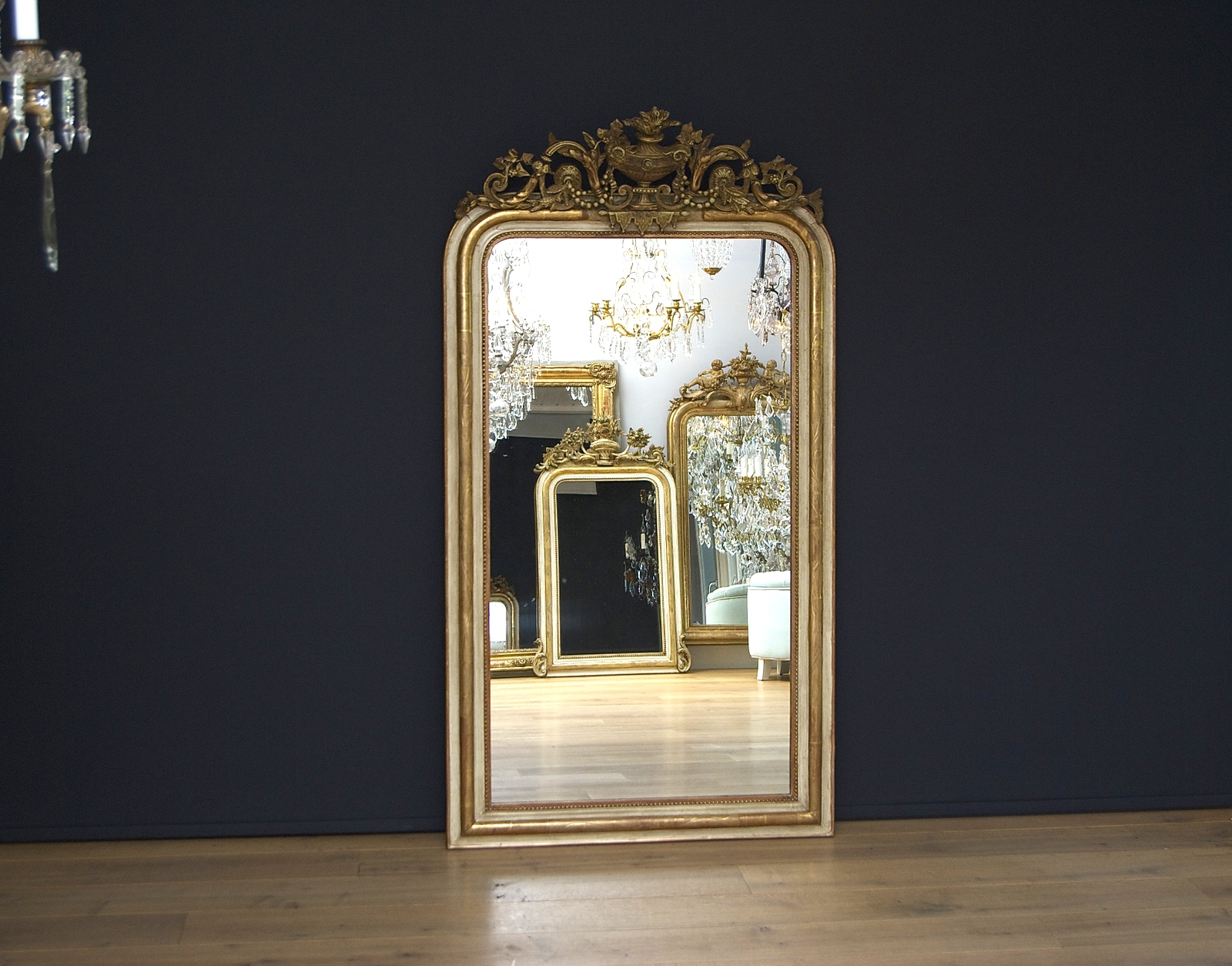 Large antique mirror with a beautiful crest
