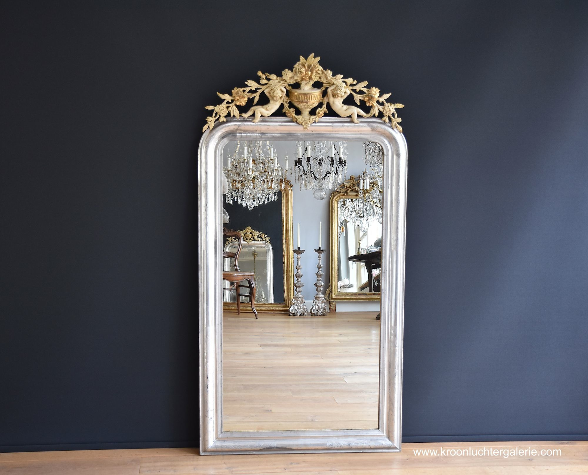 Antique French mirror with a crest, Silver-leaf