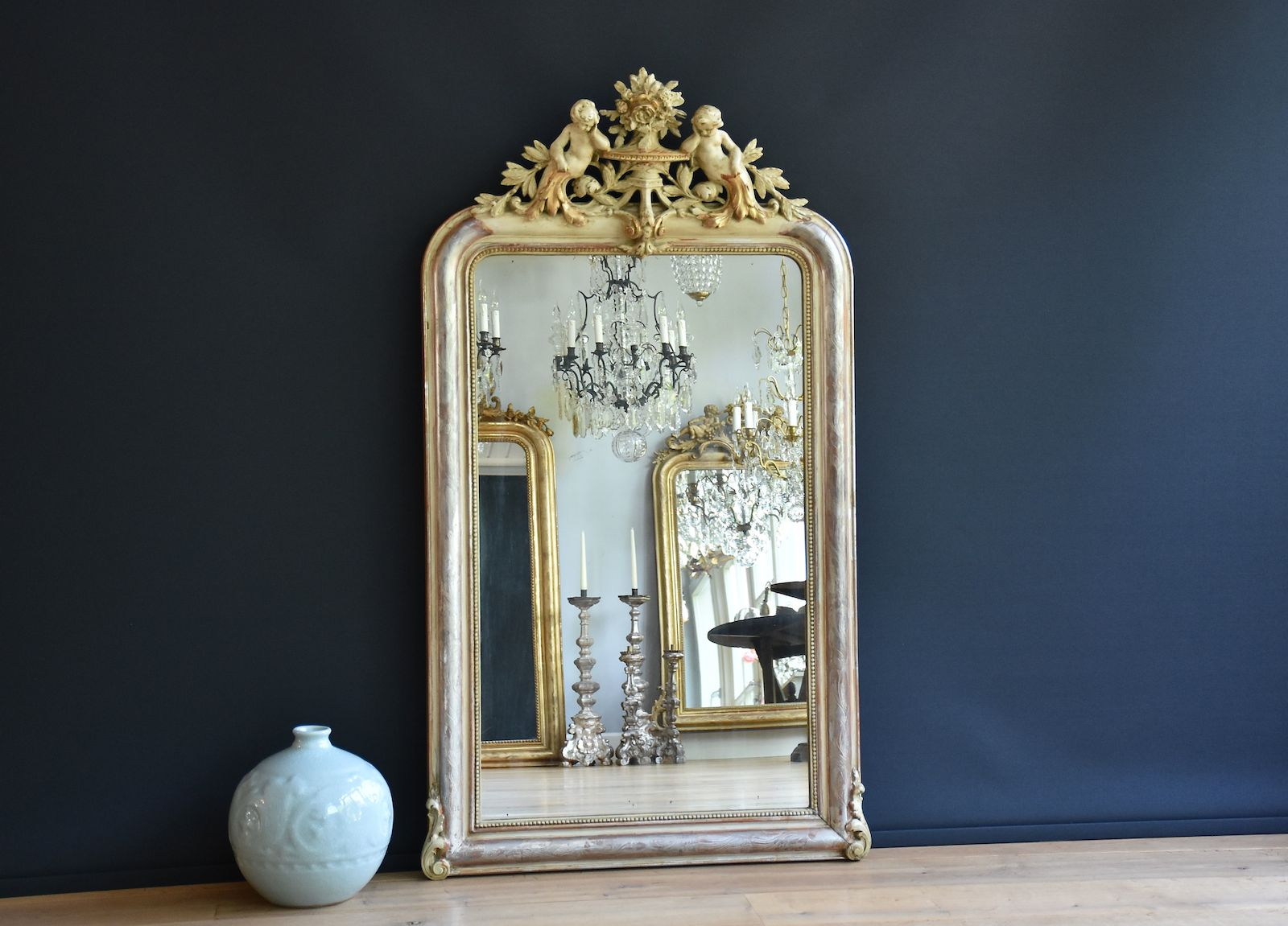 Antique French mirror with crest