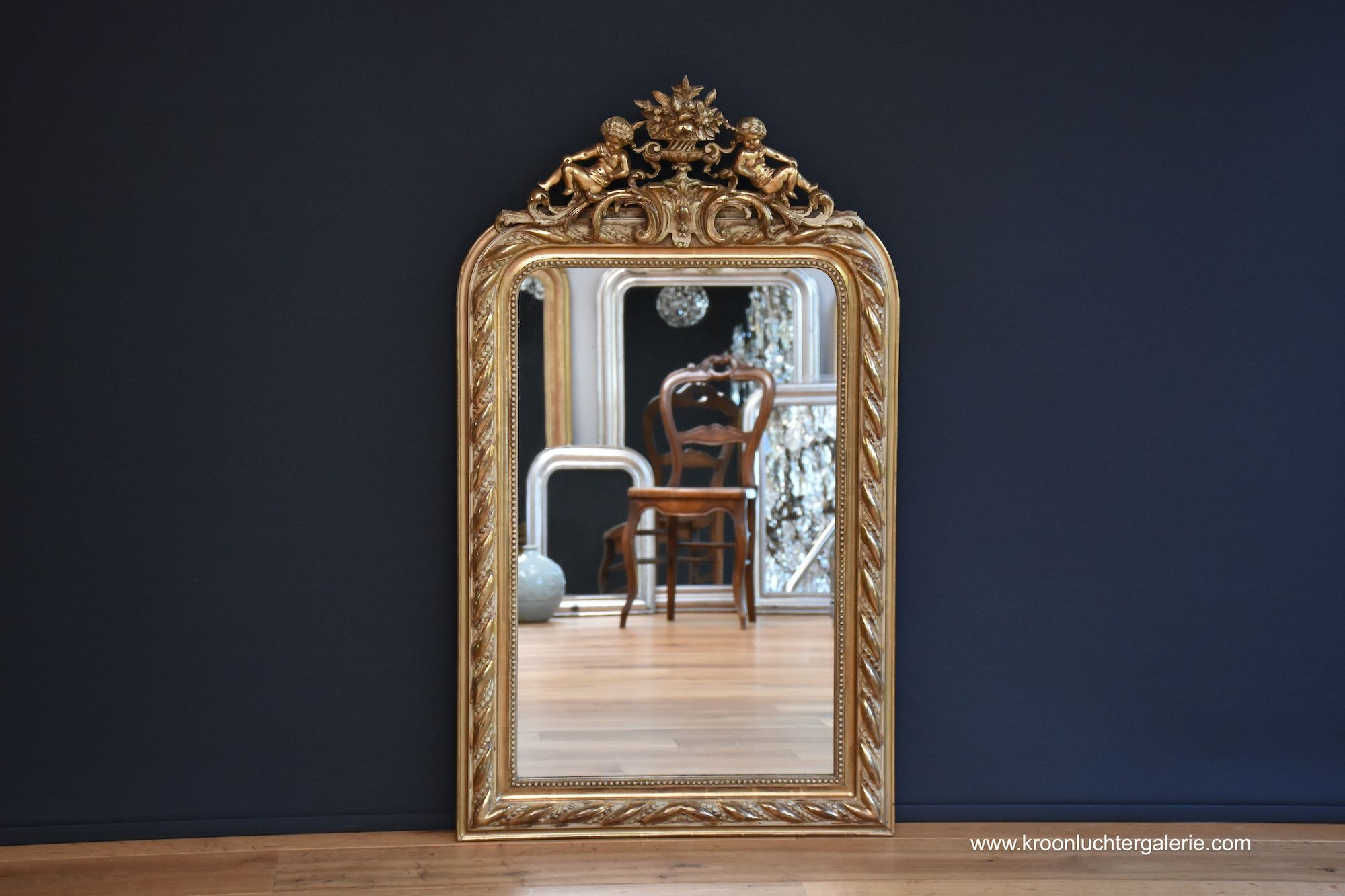 French mirror with a crest