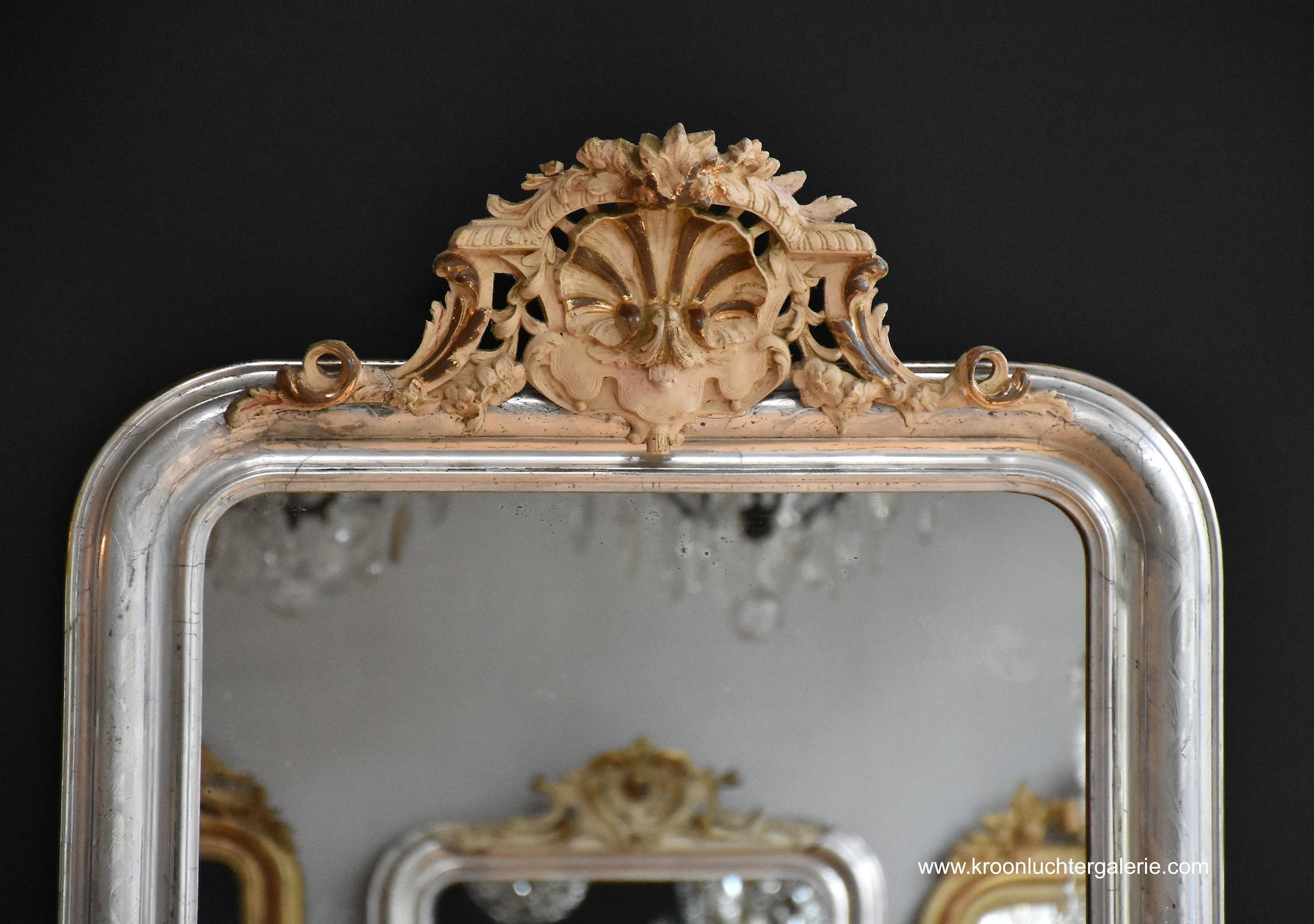 Large antique French mirror with a crest