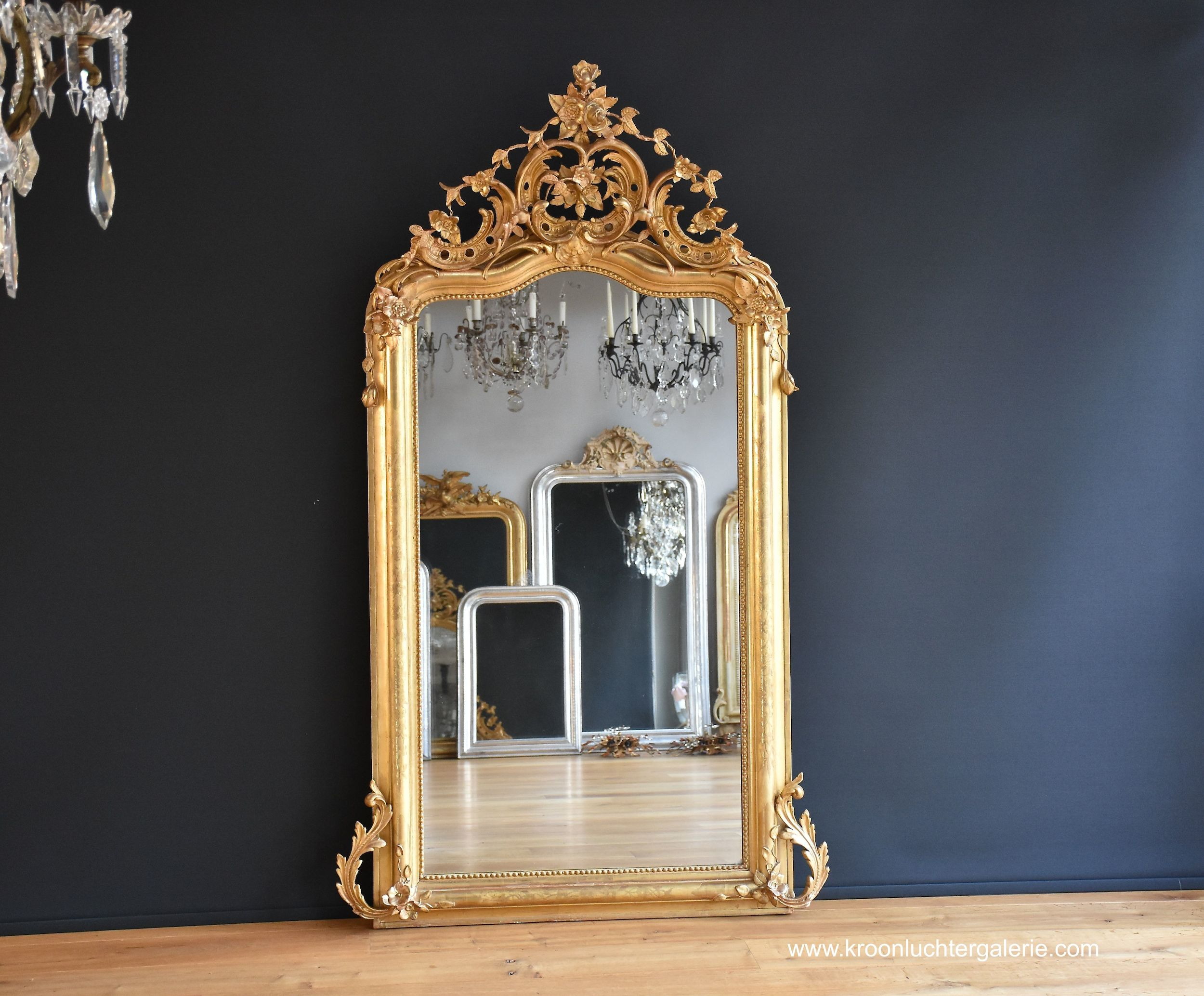 Large antique French mirror with a gorgeous crown