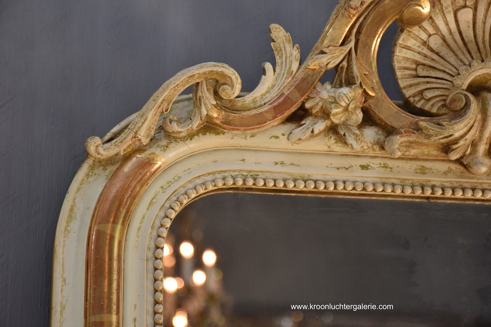 Antique French mirror with a crest