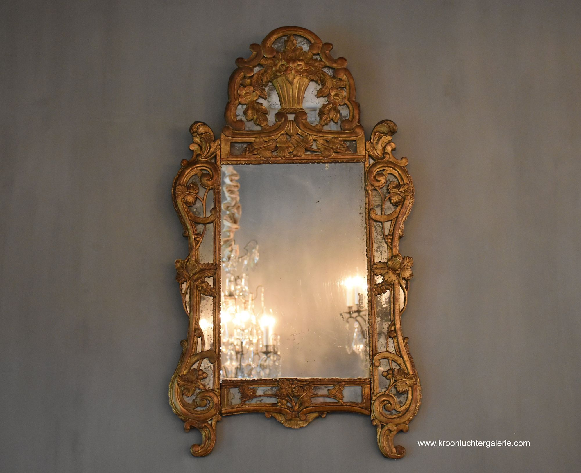 Louis XV carved and gilt wood provincial mirror