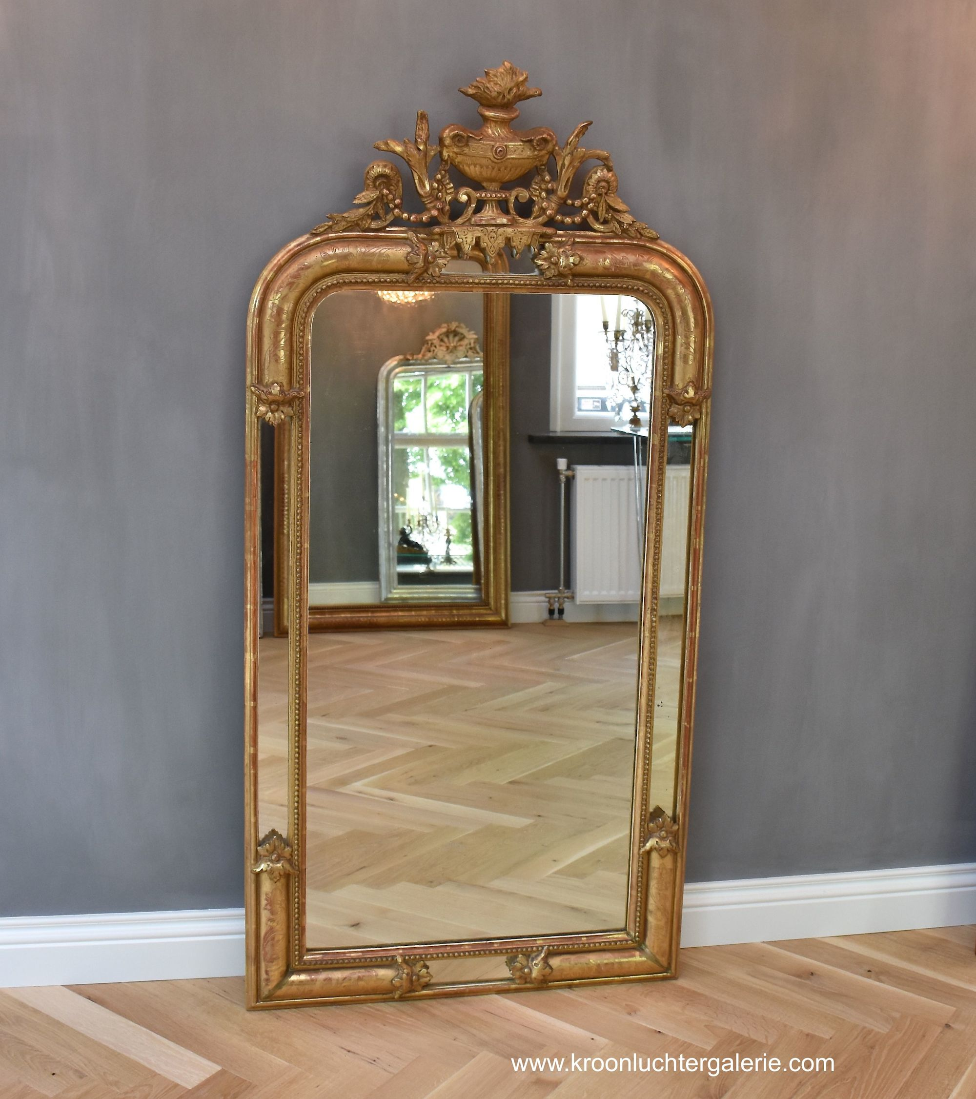 19th c.French gold-leaf mirror with a crown