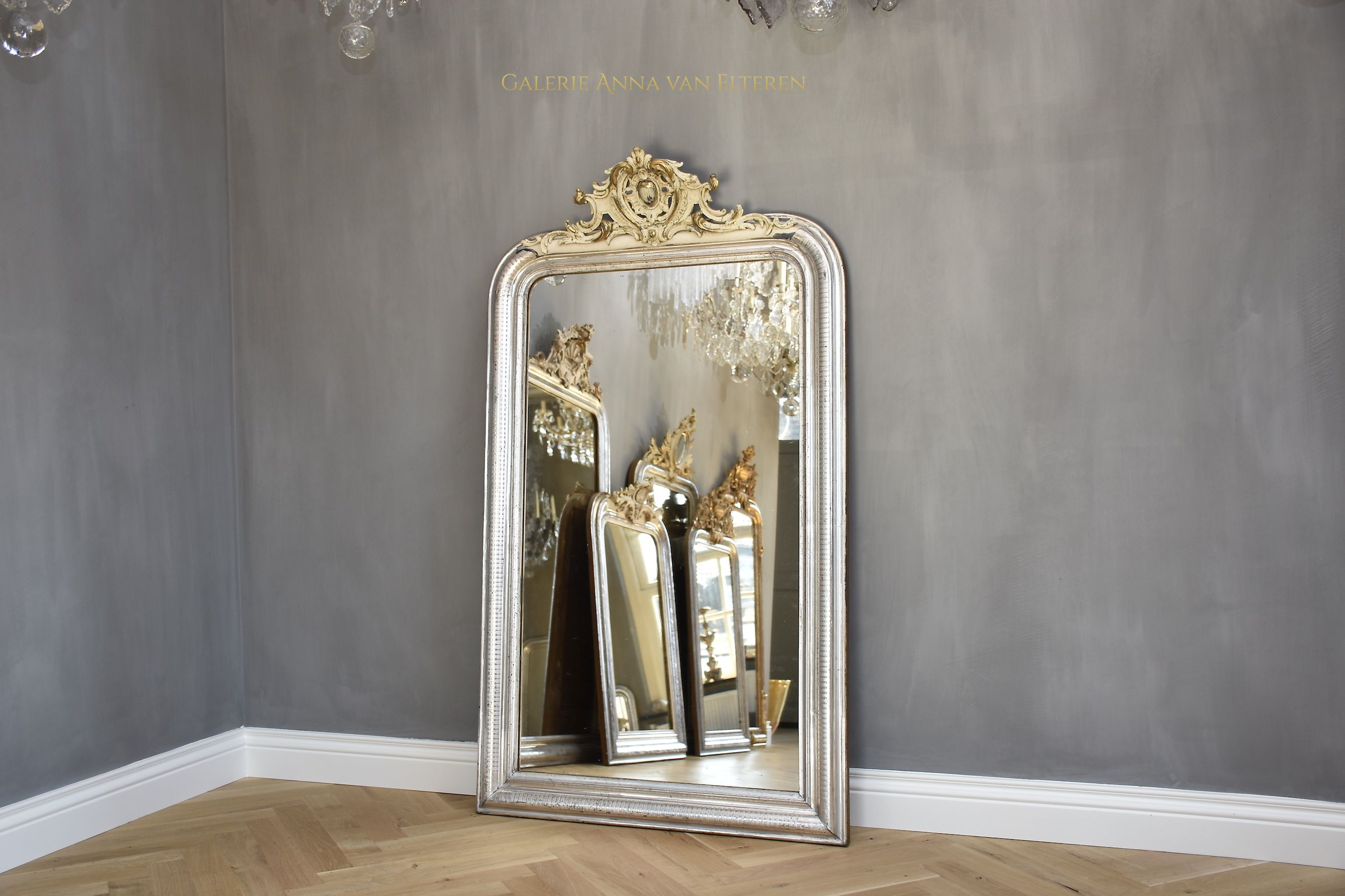 Large antique French mirror Louis-Philippe with a crest