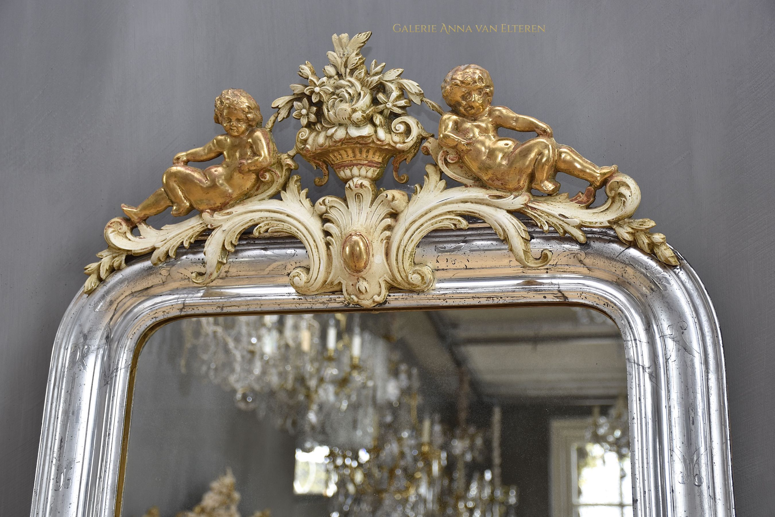 19th c. silver leaf French mirror Louis-Philippe with a crest