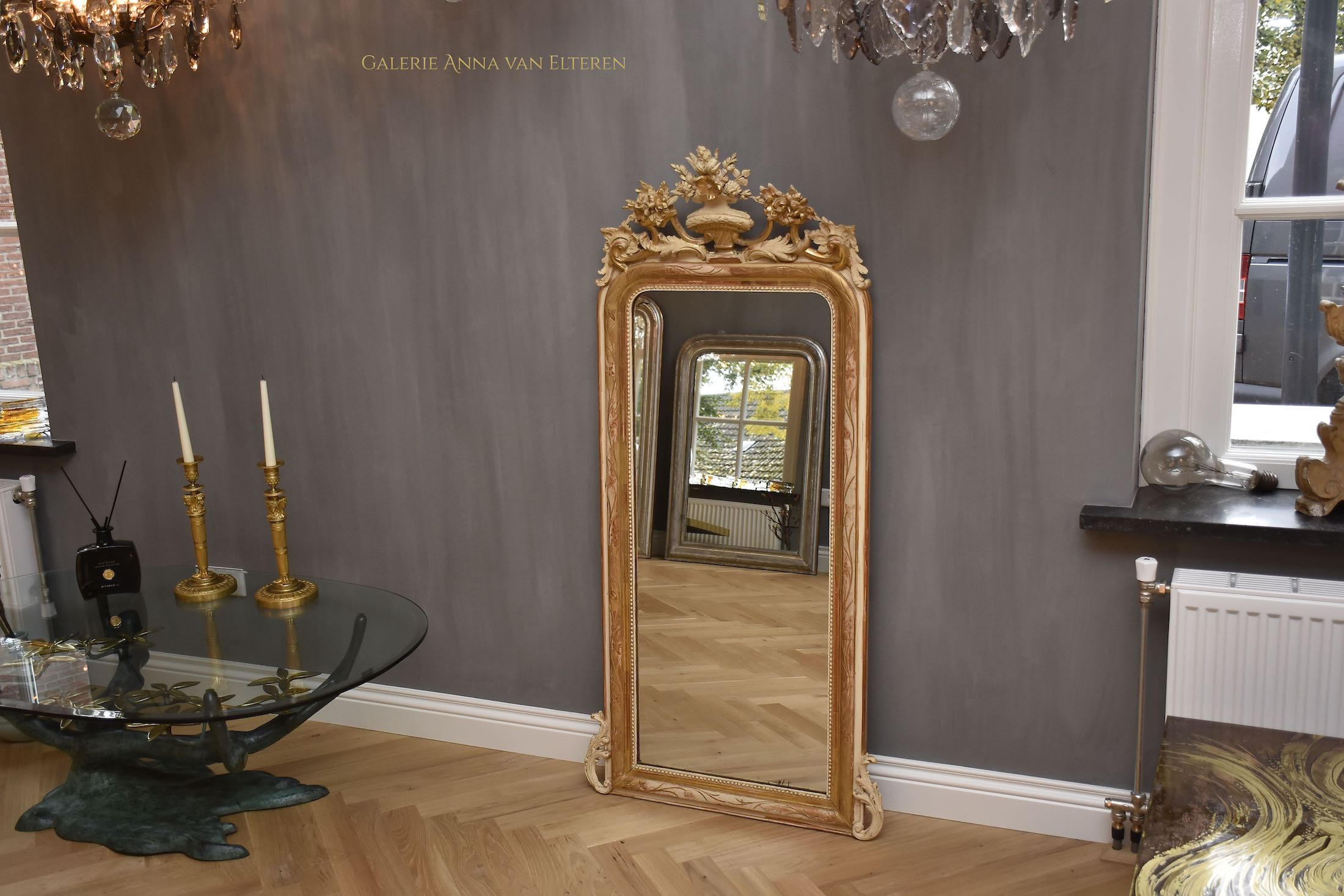 19th c. antique French mirror with a crest