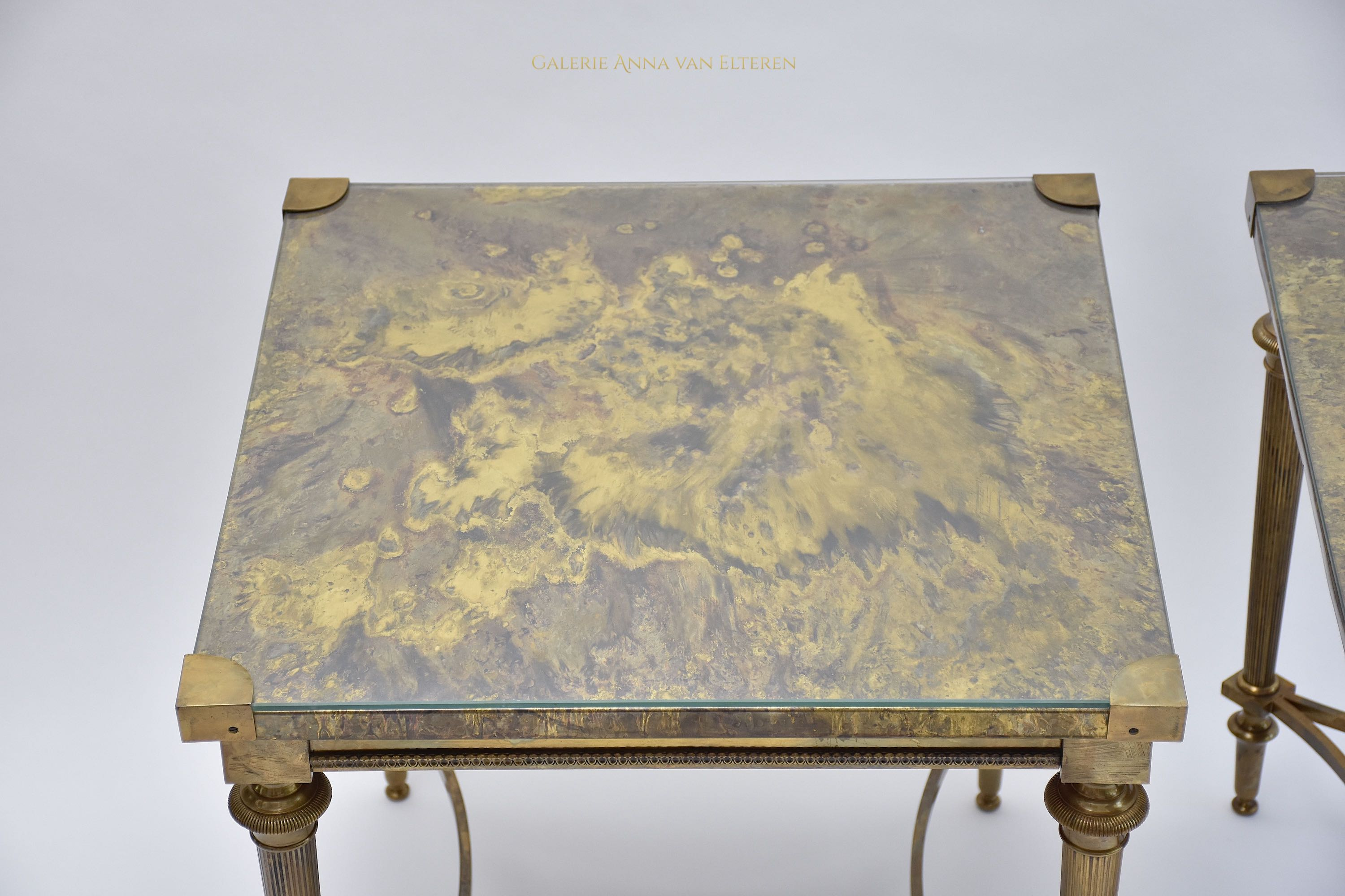 A pair of neoclassical brass side tables