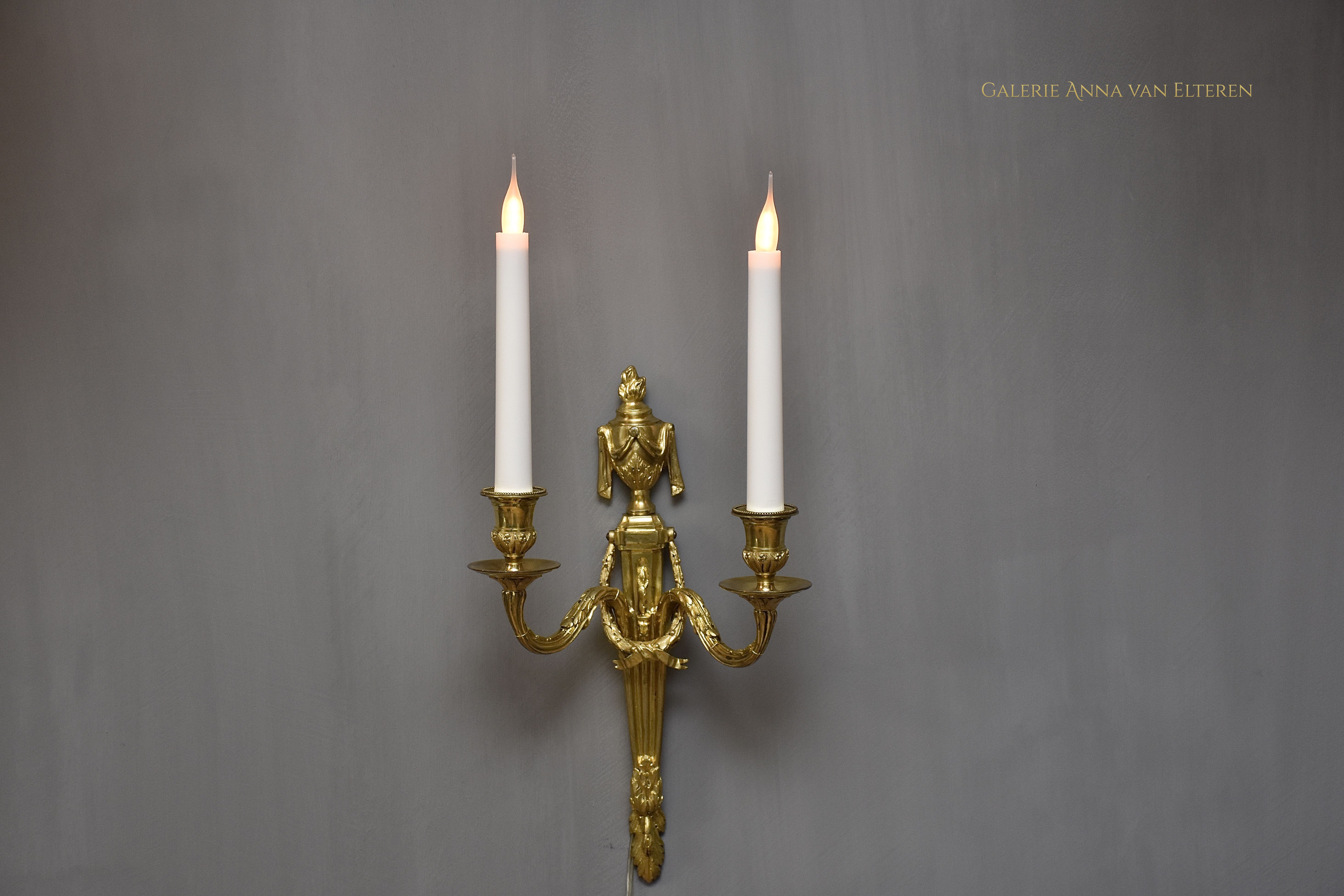 A pair of 19th c. gilt bronze wall appliques in the style of Louis XVI