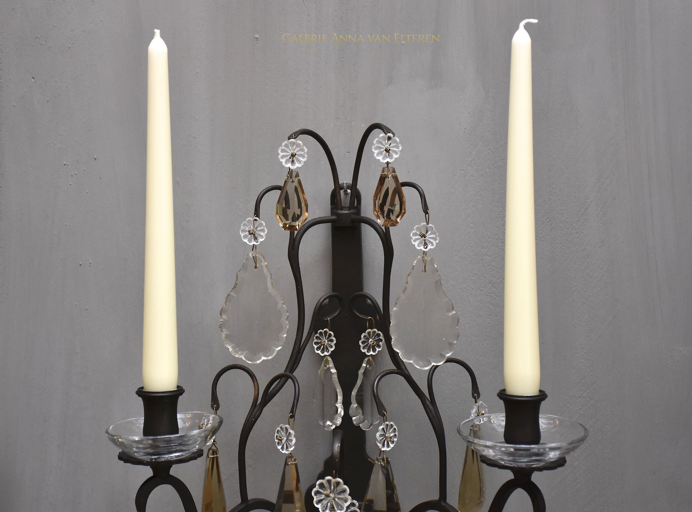 A pair of antique French wall lights