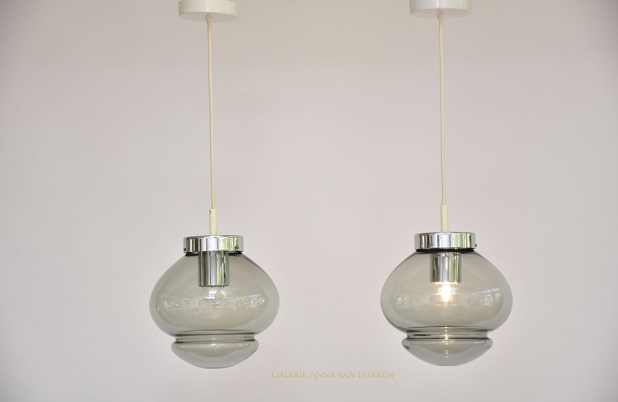 A pair of RAAK Amsterdam ceiling lamps