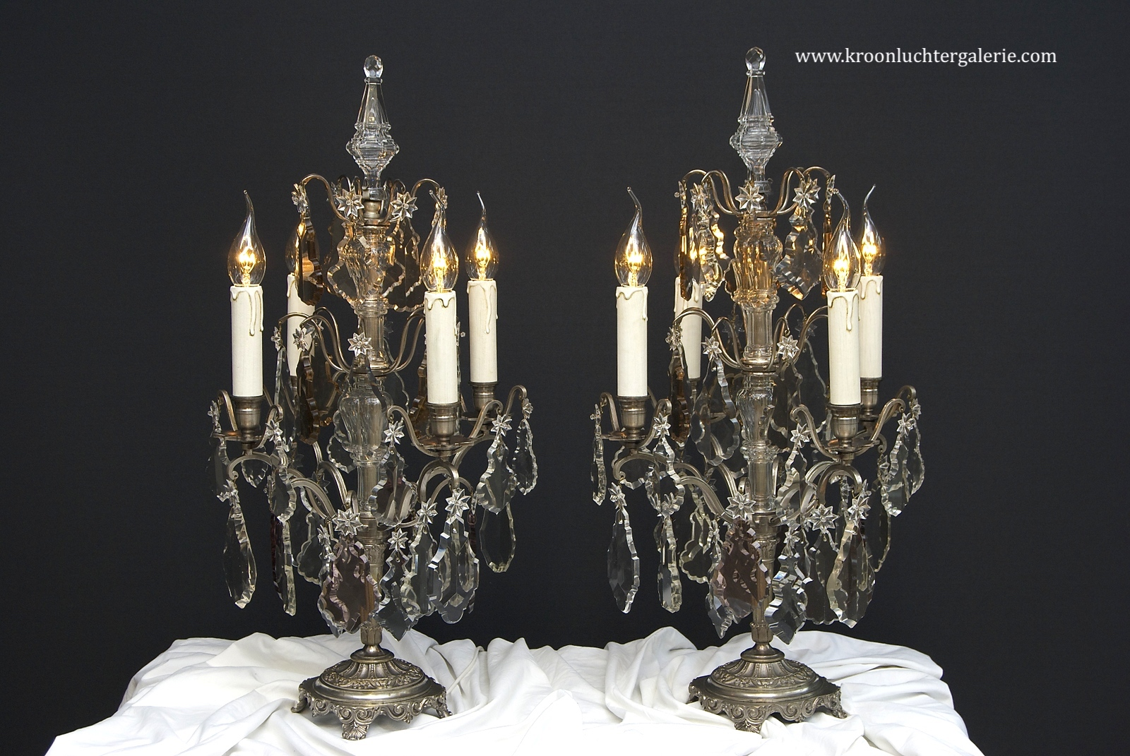 A pair of French silver-coloured table lamps/ girandoles