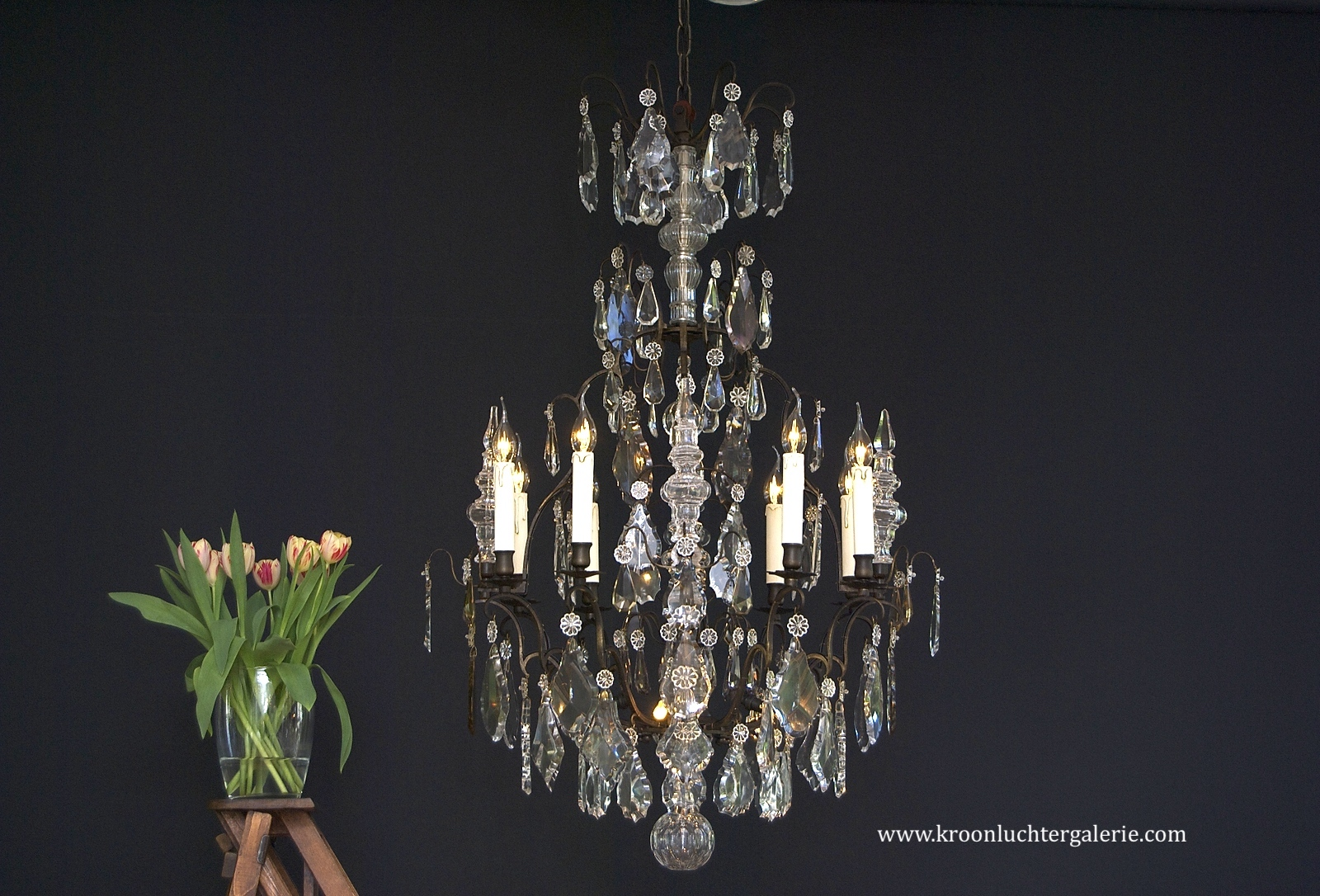 A wonderful early 20th c. French chandelier with dark patina