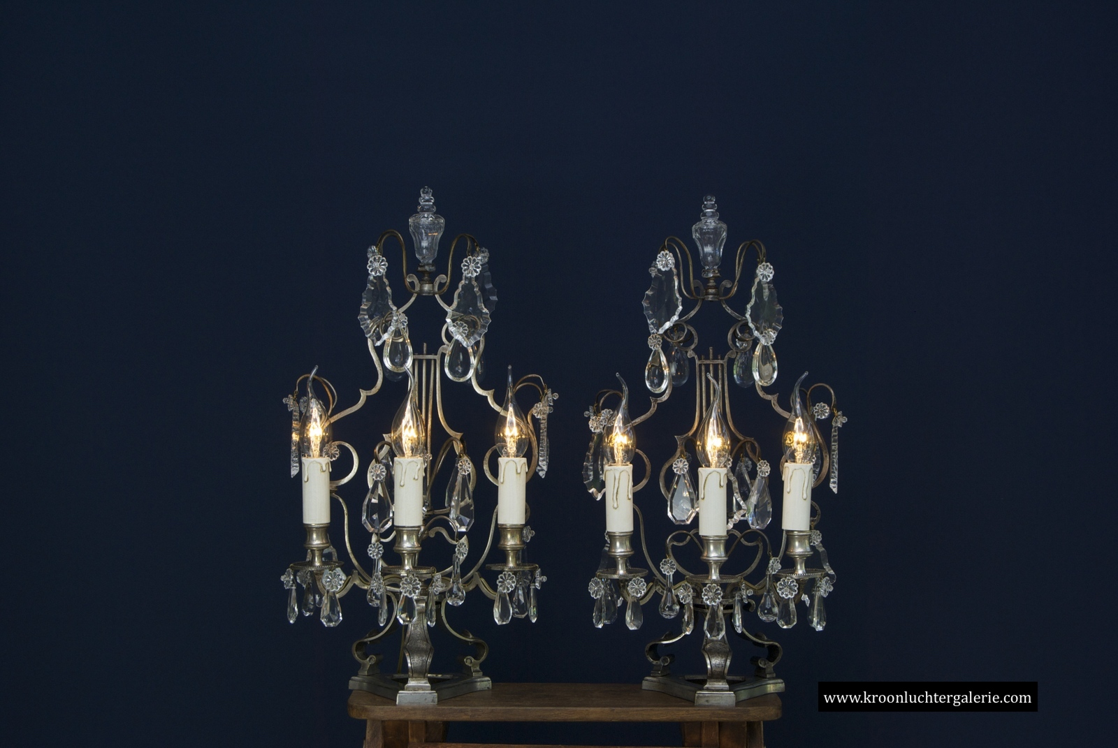 A pair of silvered bronze French girandoles