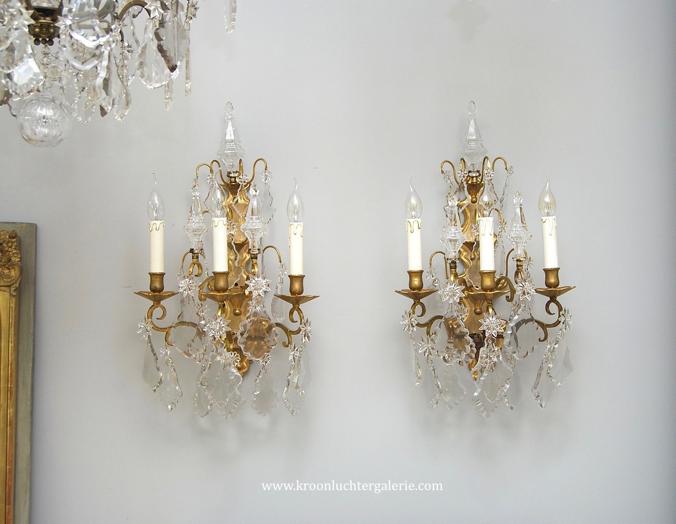 A pair of 18th century French crystal wall lights