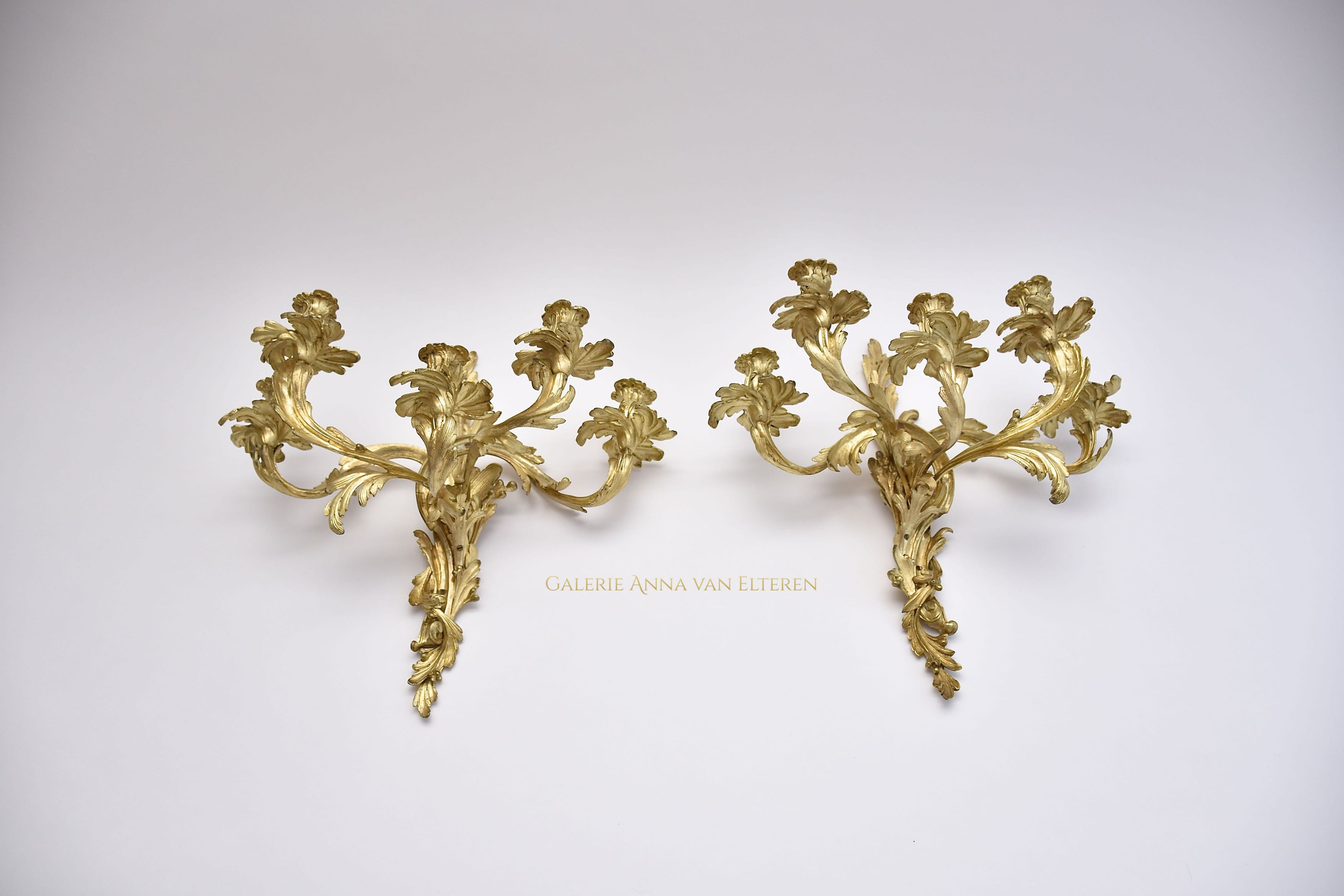 A pair of large gilt bronze wall appliques in the style of Louis XV