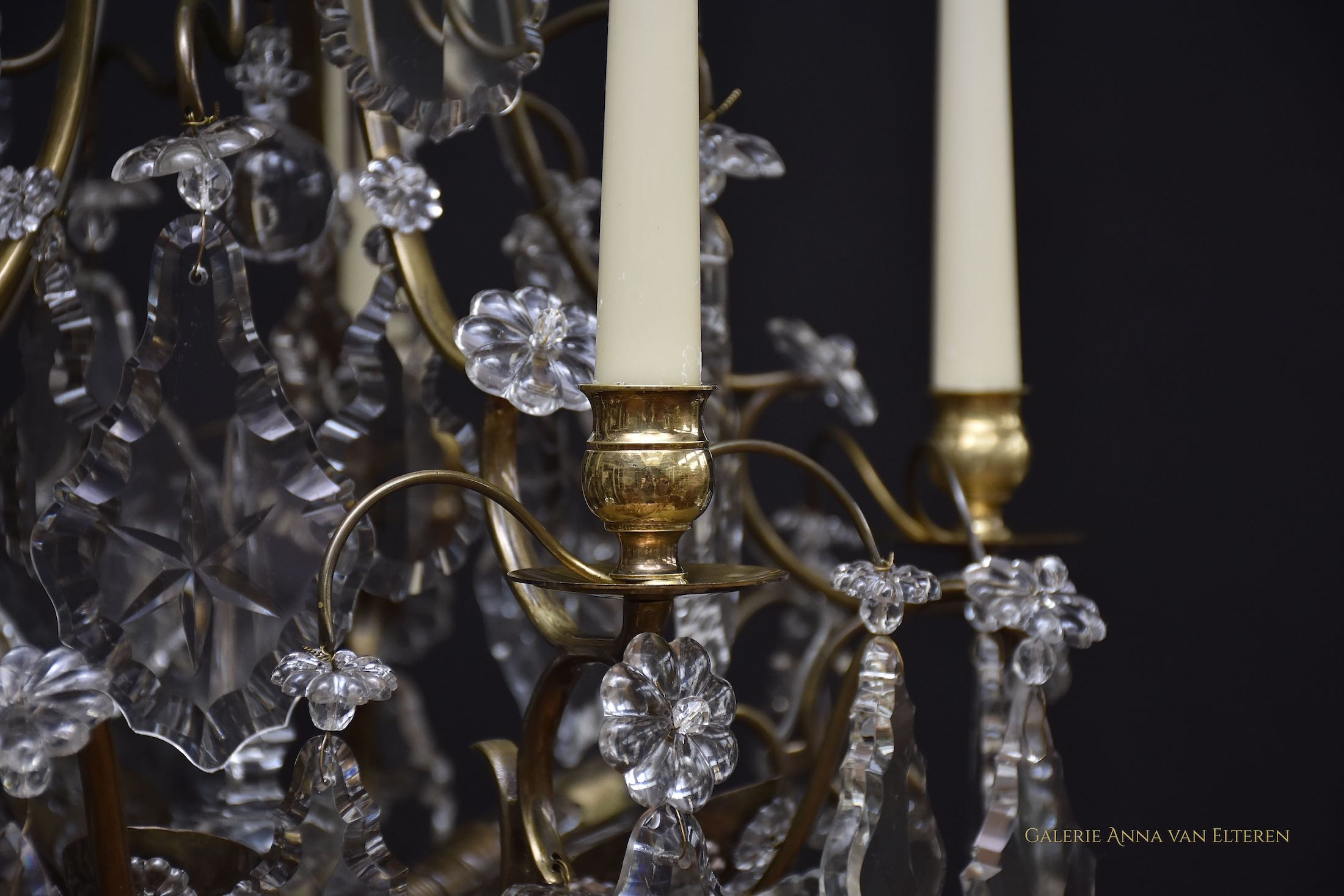 Antique chandelier with candles and lights in the style of Rococo
