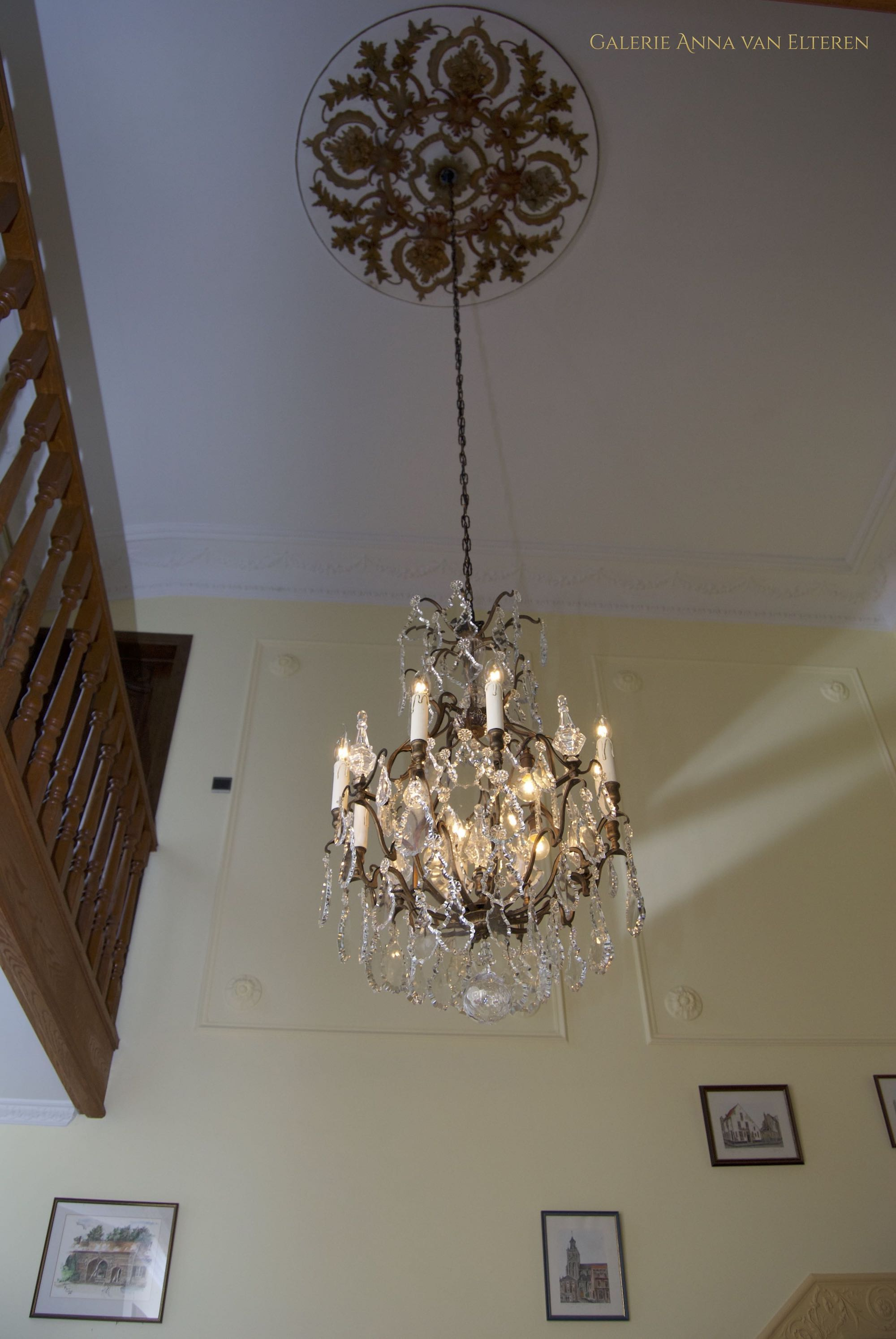Antique French chandelier in the stairwell