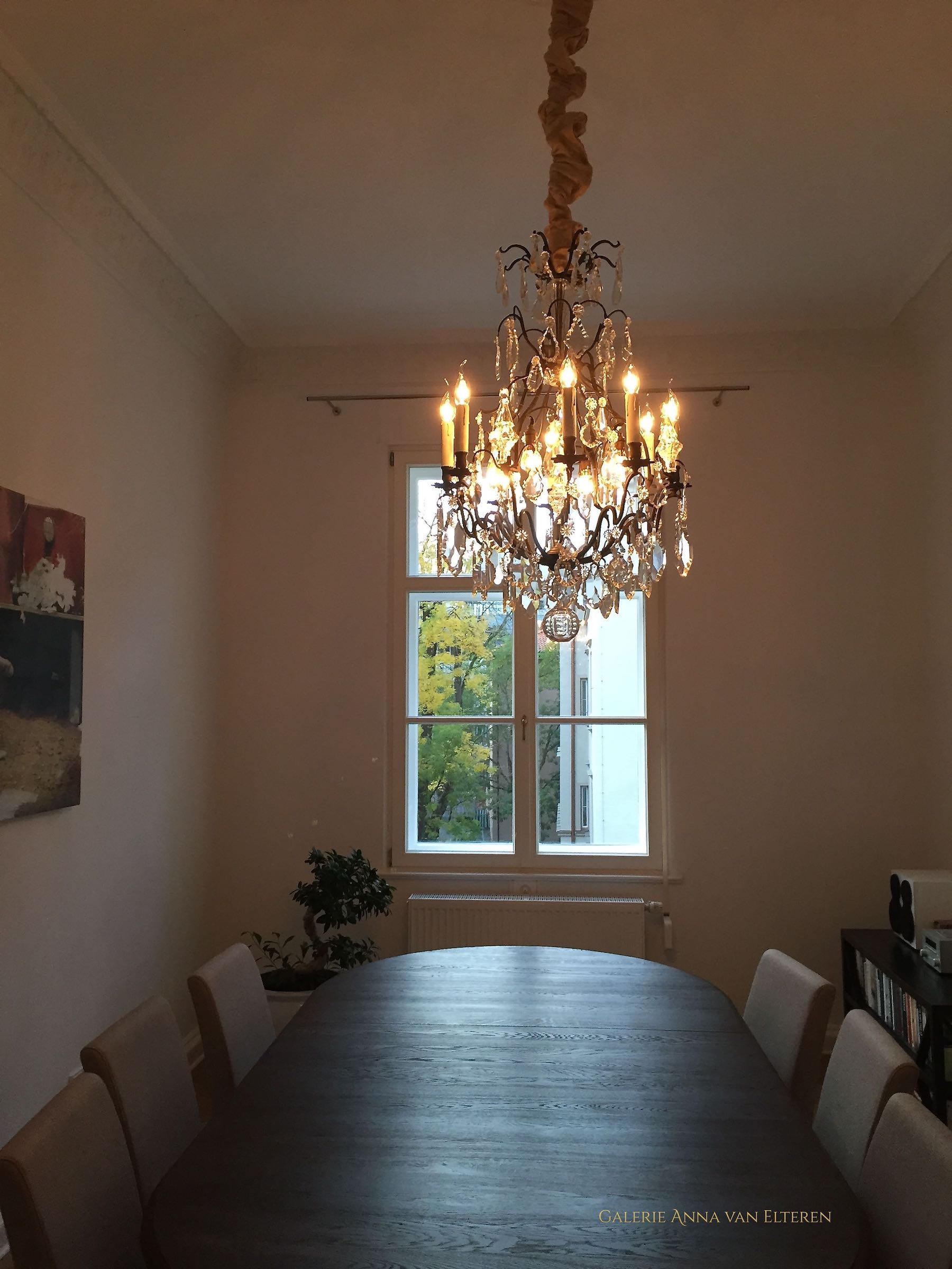 Antique French chandelier above a table