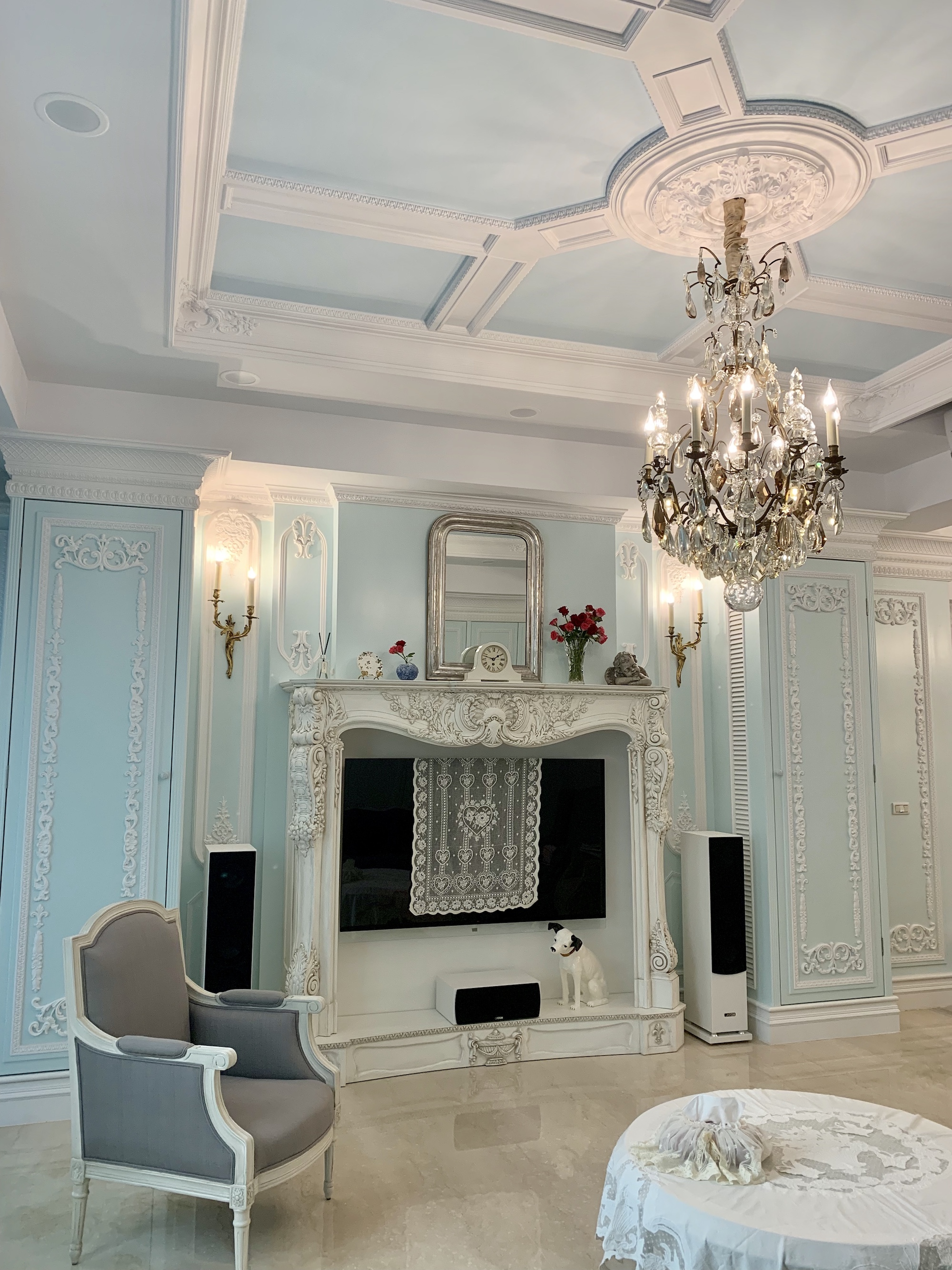 Large French chandelier, antique mirror and Rococo wall lights in the living room