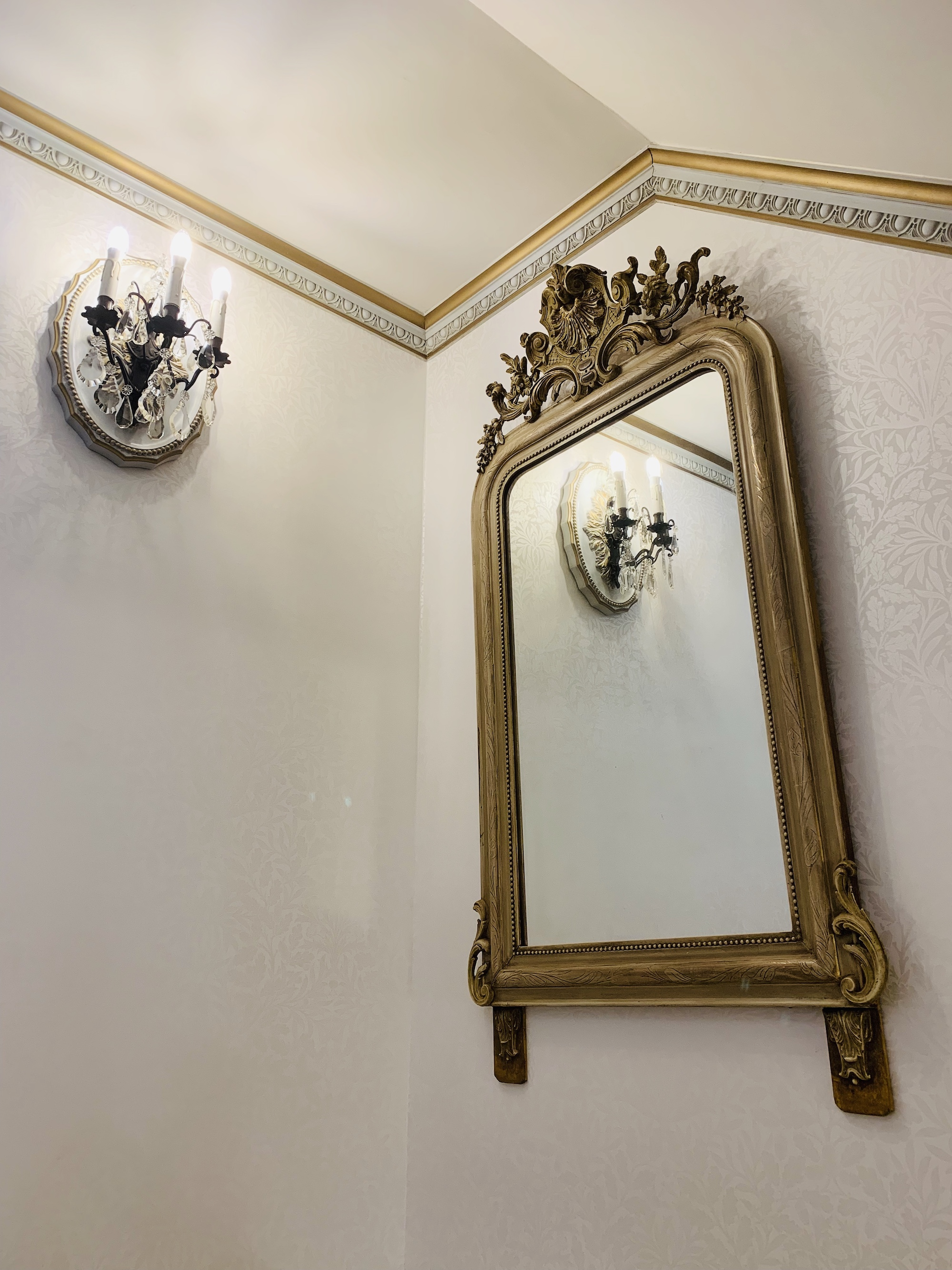 French mirror and wall lights in the stairwell