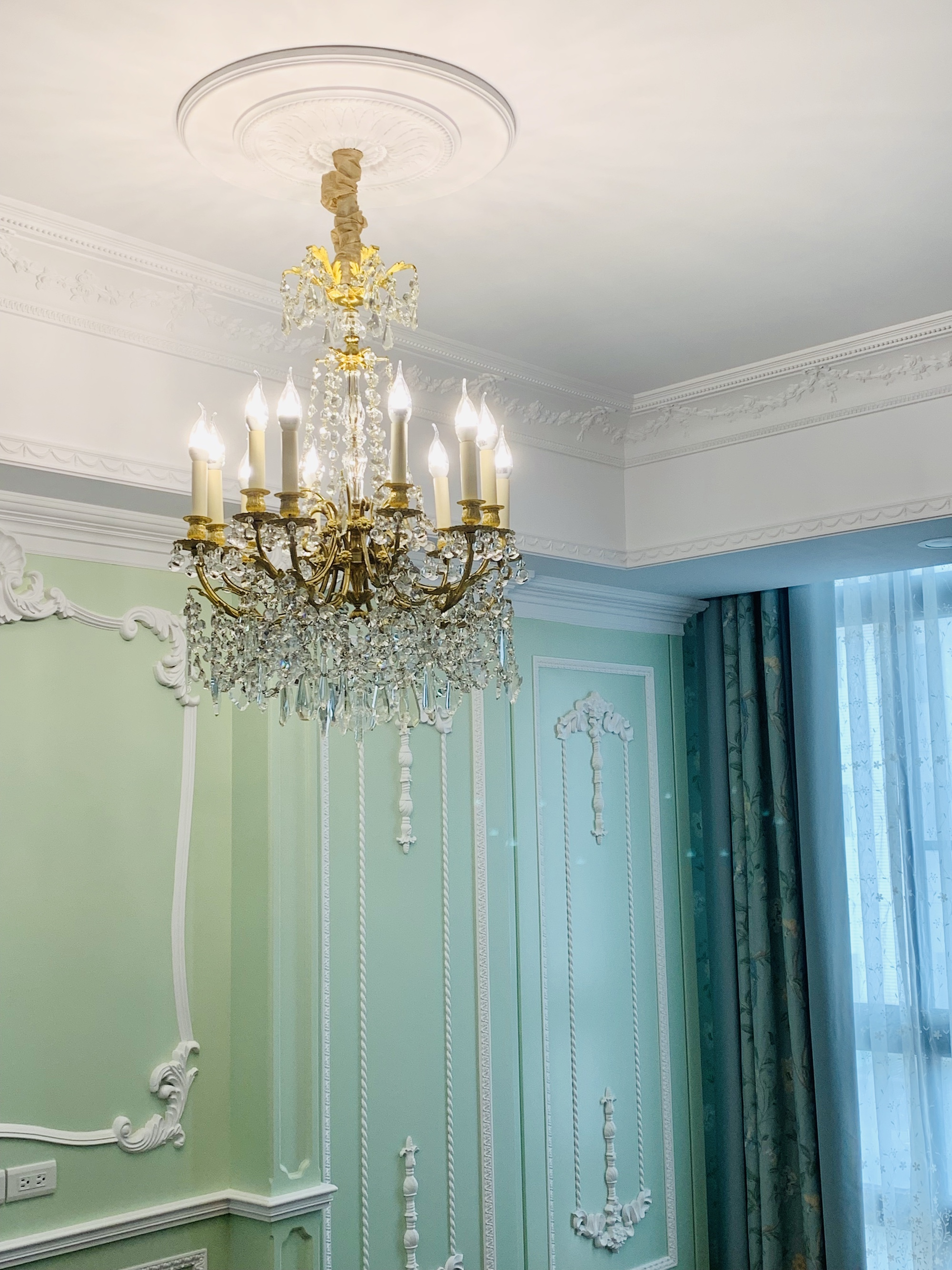 French chandelier in the style of Louis XVI in the bedroom
